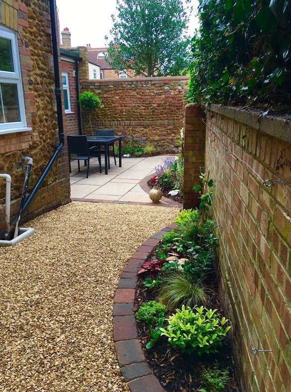 Small courtyard garden design with patio replacing rotten decking