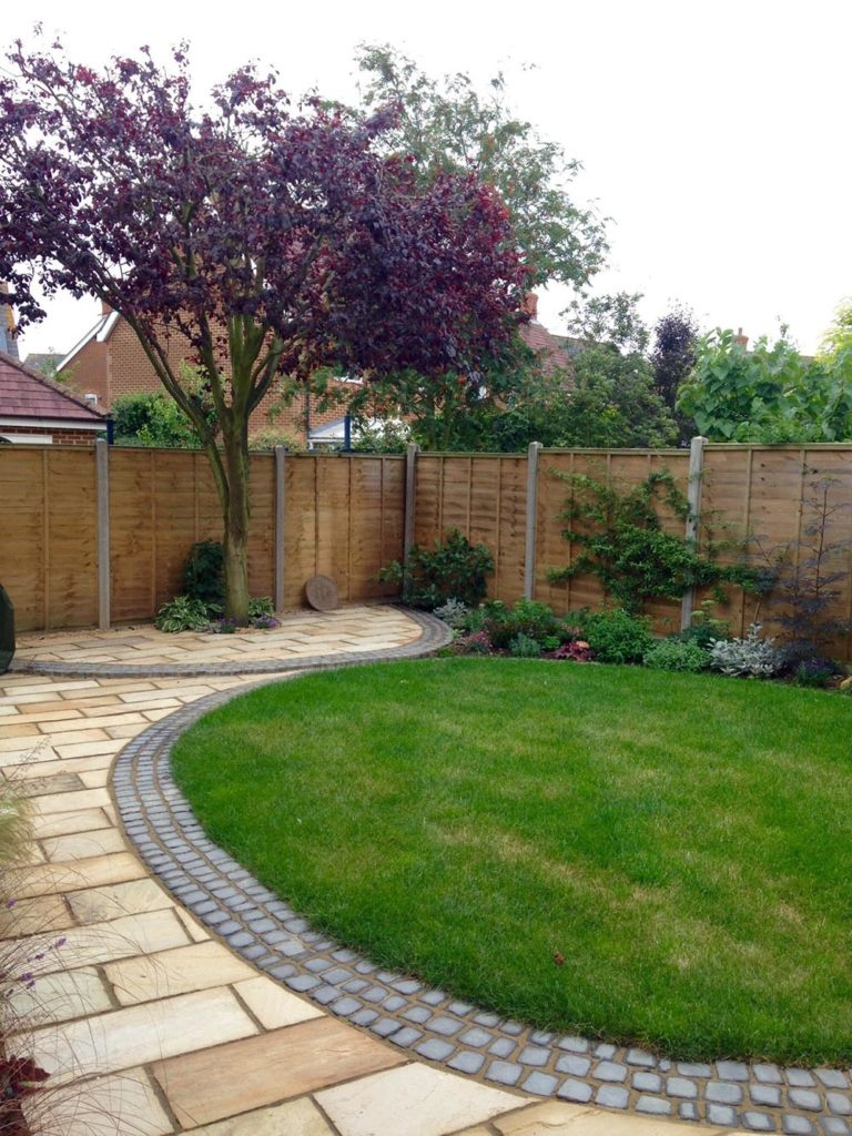 Another low maintenance hard landscaping job - lawn surrounded by brick weave and new yorkshire stone patio