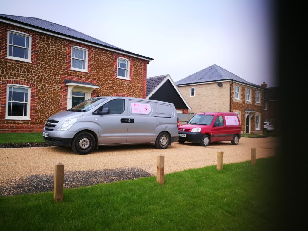 Two of our vans at a property awaiting garden makeover