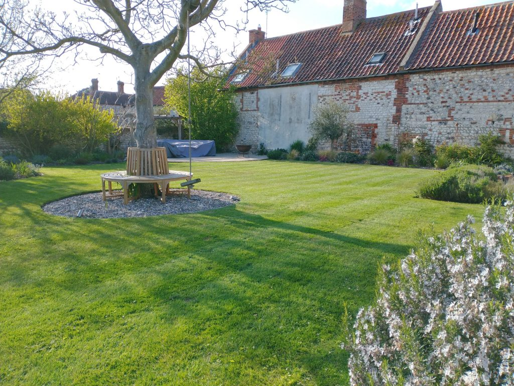 A lovely family garden in North Norfolk maintained by Balanis Garden Design